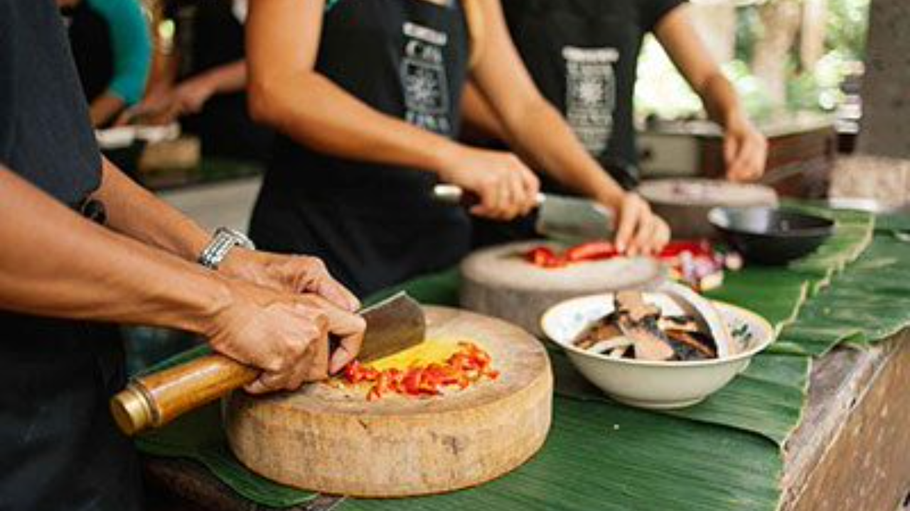 Students chopping ingredients in Ubud cooking class
