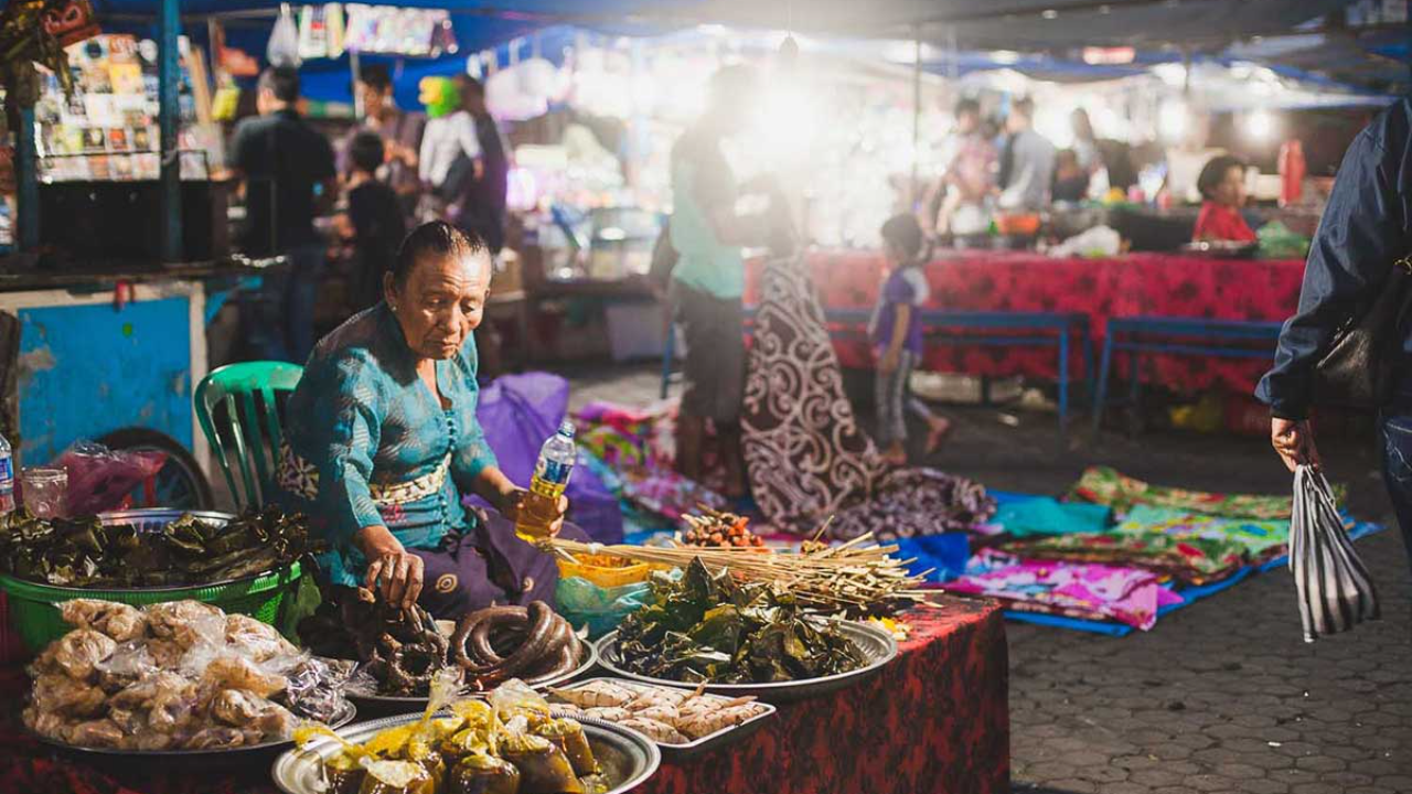 Balinese woman selling goods on a night market